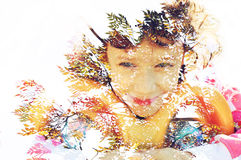 Double exposure of Colorful tree foliage in the autumn and cute happy kid Stock Photos