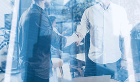 Double exposure concept.Business partnership handshake.Photo two bearded businessmans handshaking process.Successful Stock Photography
