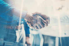 Double exposure concept.Close up view of business partnership handshake .Photo two businessman handshaking process Stock Image