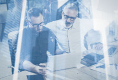 Double exposure concept.Team of business people making great work discussion in studio.Young bearded man showing. Double exposure concept.Team of business people Stock Image