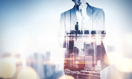 Double exposure concept with thinking businessman and city. With. Double exposure concept with thinking businessman and city Royalty Free Stock Photos