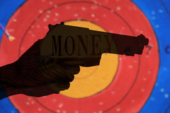Double exposure condo of gun with coins background, Finance and banking concept Stock Image
