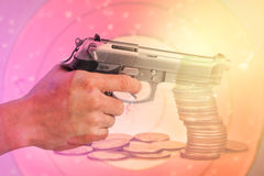 Double exposure condo of gun with coins background, Finance and banking concept Stock Photos