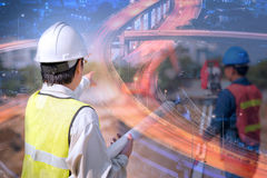 Double exposure construction engineer with new expressway stock photo