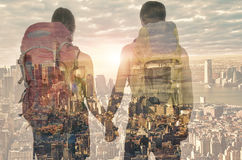Double exposure of a couple in front of New York city Stock Photos