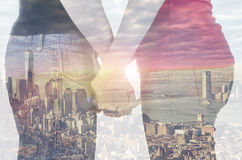 Double exposure of a couple in front of New York city Royalty Free Stock Photography