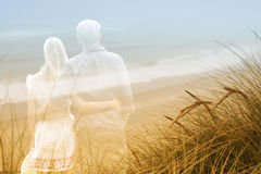 Double exposure of couple and sandy beach Royalty Free Stock Photos