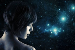 Double exposure. Creative double exposure portrait of young woman combined with space scene Stock Photos