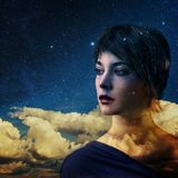 Double exposure. Creative double exposure portrait of young woman combined with space scene Royalty Free Stock Images