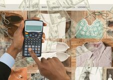 Double exposure of cropped hands using calculator with fashion accessories and currencies. Digital composite of Double exposure of cropped hands using calculator Stock Image