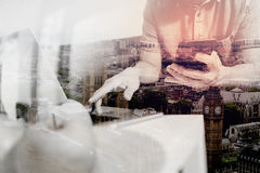 Double exposure of designer man hand using laptop compter and mo Stock Image