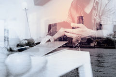 Double exposure of designer man hand using laptop compter and mo Stock Photo
