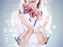 Double Exposure Doctor with stethoscope and penis on the hands in a hospital. Royalty Free Stock Photo
