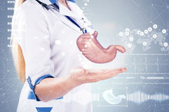 Double Exposure, Doctor with stethoscope and stomach on the hands . gray background. Double Exposure, Doctor with stethoscope and stomach on the hands, gray Royalty Free Stock Image