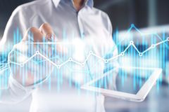 Double exposure economic charts and graphs on virtual screen. Online trading, Business and finance concept. stock photo