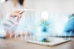 Double exposure economic charts and graphs on virtual screen. Online trading, Business and finance concept. royalty free stock photo