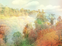 Double exposure effect of autumnal trees, river royalty free stock image