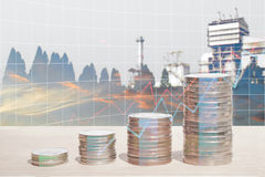 Double exposure of energy business and finance concepts. Double exposure of energy business and finance, Money coin stack with growing graph, Blurred power Royalty Free Stock Photos
