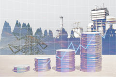 Double exposure of energy business and finance concepts. Double exposure of energy business and finance, Money coin stack with growing graph, Blurred power Royalty Free Stock Photo