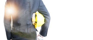Double exposure of Engineer holding helmet on Electric pole stock photos