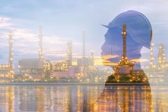 Double exposure of engineer and refinery stock image