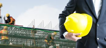 Double exposure Engineer with safety helmet on construction. Site workers Stock Photography