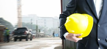 Double exposure Engineer with safety helmet. On construction site workers Royalty Free Stock Image