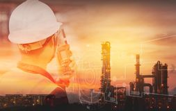 Double exposure of Engineer with safety helmet with oil refinery industry plant background. Industrial instruments in the factory. And physical system icons royalty free stock photos