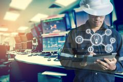 Double exposure of Engineer or Technician man with business industrial tool icons while using tablet with monitor of computers. Room for oil and gas industrial stock photos