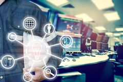 Double exposure of Engineer or Technician man with business industrial tool icons holding safety hat with monitor of computers stock photos