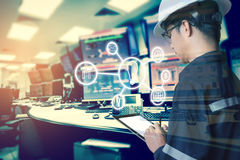 Double exposure of Engineer or Technician man with business industrial tool icons while using tablet with monitor of computers. Room for oil and gas industrial stock image