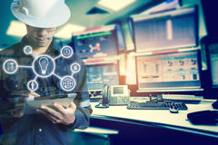 Double exposure of Engineer or Technician man with business industrial tool icons while using tablet with monitor of computers. Room for oil and gas industrial royalty free stock photos