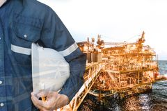 Double exposure of Engineer or Technician man holding safety hat. With offshore oil and gas  for energy and petroleum industrial business concept Stock Photography