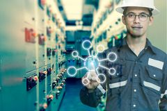 Double exposure of Engineer or Technician man pointing finger co. Ntrol switch gear electrical room oil and gas platform or plant industrial with blank tools stock photos