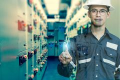 Double exposure of  Engineer or Technician man press his finger. Action in switch gear electrical room of oil and gas platform or plant industrial for monitor Stock Image