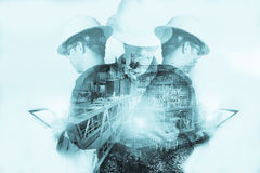 Double exposure of Engineer or Technician man with safety helmet. Operated platform or plant by using tablet with offshore oil and gas platform background for Stock Photos