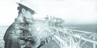 Double exposure of Engineer or Technician man with safety helmet operated platform or plant by using tablet with offshore oil and stock images