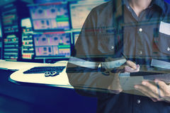 Double exposure of  Engineer or Technician man in working shirt. Working with tablet in control room of oil and gas platform or plant industrial for monitor Royalty Free Stock Images