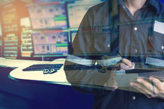 Double exposure of  Engineer or Technician man in working shirt. Working with tablet in control room of oil and gas platform or plant industrial for monitor Stock Image