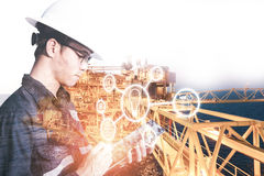 Double exposure of  Engineer or Technician man in working shirt. Working with tablet in control room of oil and gas platform or plant industrial for monitor Stock Images