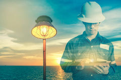 Double exposure of  Engineer or Technician man in working shirt Royalty Free Stock Images