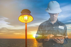 Double exposure of  Engineer or Technician man in working shirt Stock Images
