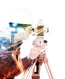 Double exposure of engineer working with survey equipment theodolite on a tripod against the city isolated on white royalty free stock photos