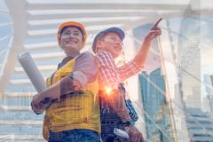 Double exposure engineering tools and construction concept. Industrial engineer wear safety helmet engineering standing with arms. Crossed holding inspection royalty free stock photo