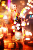 Double exposure fashion photo of blonde woman in night car traffic. Stock Photos