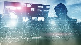Double exposure gears mechanism on blurred background. Business and industrial process automation concept. stock images