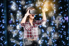 Double exposure, girl getting experience using VR glasses, being in virtual reality, choosing toys stock photography