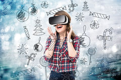 Double exposure, girl getting experience using VR glasses, being in virtual reality, choosing toys royalty free stock photos