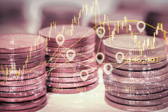Double exposure gold coins money and graph economy Stock Photos