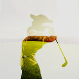 Double exposure of golf player. Double exposure of young female golf player holding club combined with green field and sky. Golfing concept Stock Photography